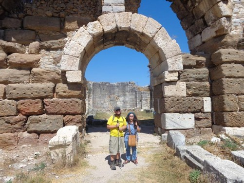 Tony and Tatiana standing in front of another entrance archway passing through thick stone walls. Part of the Faustina Baths.