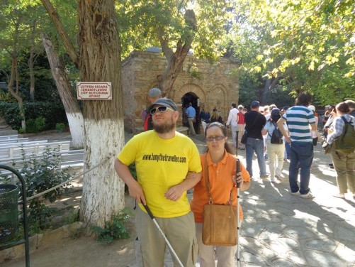Tony and Tatiana outside the House of the Virgin Mary, near Ephesus. This Catholic shrine is believed by some to be the location where Mary was taken by Saint John and lived until her Assumption. It was discovered by a German nun named Anne Catherine Emmerich in the early 19th century. A chapel now stands on the site, incorporating the original house.