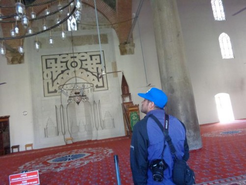 Inside the Isa Bey Mosque. Looking towards the mihrab, an alcove in the wall, indicating the direction of Mecca that Muslims face when praying.