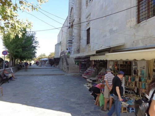 Stalls selling souvenirs in the street directly in front of the Isa Bey Mosque.