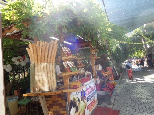 A cobbled street lined with stalls selling local products in Sirince village.