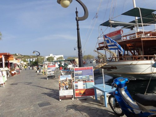 View of the harbour in Samos Town. A line of restaurants down the side.