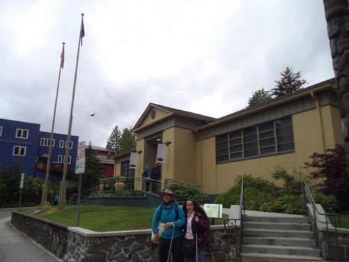 Outside the Juneau-Douglas City Museum, opposite the State Capitol. Tatiana and Tony in front. This small museum includes displays on gold mining, native artefacts and city history.