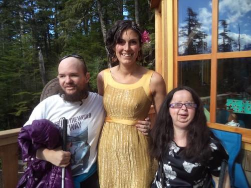 Tony and Tatiana with Joey on the balcony of her log cabin.