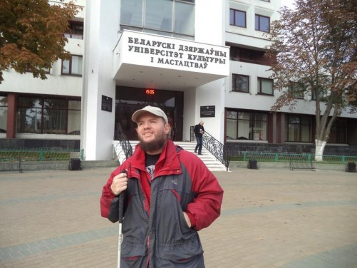 Tony outside the main entrance to the Belarusian State University of Culture and Arts. Established in 1975. The building is a large white-painted eight storey block.