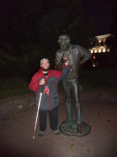 Tony touching a hand of the 'Smoking Man' statue, again in Mikhailovsky Park. The park is located near the main train station in the city centre.