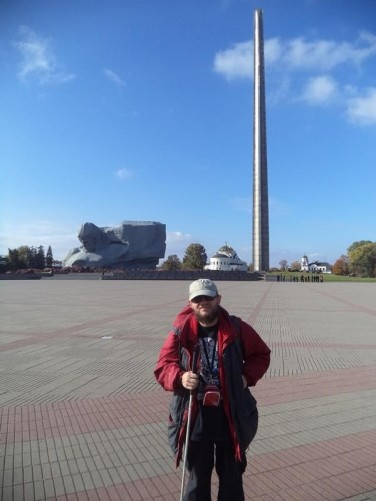 Tony in the large Ceremonial Square. At the far side the 104.5 metre tall Bayonet Obelisk.