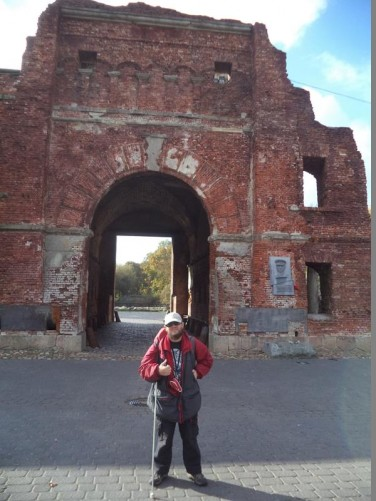 Tony at Terespol Gate. One of four gates leading into the fortress's citadel. This large brick built gate dates from the early 19th century. It was badly damaged in World War II with the upper part destroyed.
