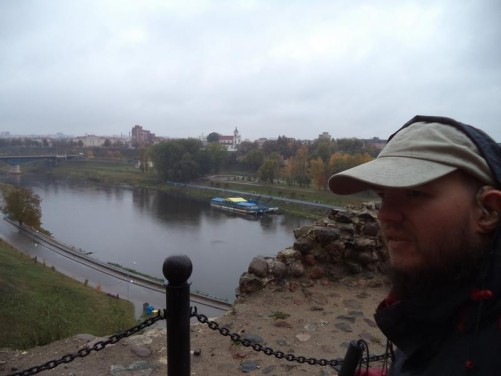 A good view looking south-east along the Neman River from the castle ramparts. Sloping grassy banks lining the river.