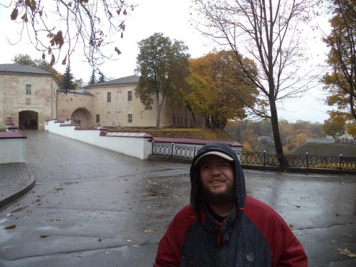 Tony in the rain. Behind the 300-year-old arch bridge linking the old and new castles.