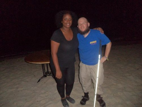 Tony on the beach in the evening with a waitress from the beach café.