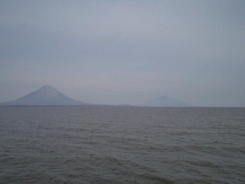 View of Concepción and Madera volcanoes from aboard a large ferry crossing Lake Nicaragua. These volcanoes are on the island of Ometepe. Lake Nicaragua is Nicaragua's largest lake.