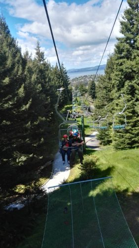 Tony and Tatiana ride a chairlift at Skyline Rotorua, North Island, New Zealand