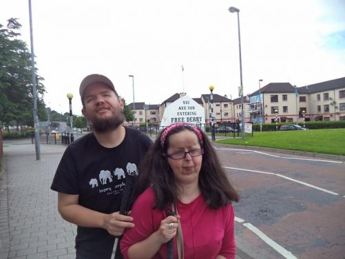 Tony and Tatiana with the 'You are now entering free Derry' mural behind. This is located in the city's Bogside neighbourhood, which contains numerous murals.