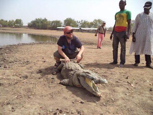Tony sitting on the crocodile!