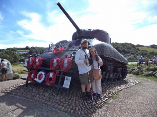 Tatiana and Tony next to a WWII US Sherman Tank, part of the Exercise Tiger Memorial