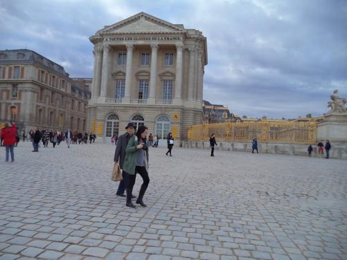 The entrance courtyard (Cour d'Honneur) at the Palace of Versailles looking towards the south wing of the palace.