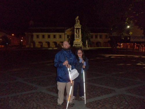 Tony, Tatiana in front of the Town Hall in Széchenyi Ter, Esztergom's main square. An equestrian statue of the building's original owner can be seen behind.