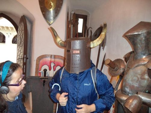Tony wearing a medieval metal round pot-shaped helmet adorned with two bull's horns!