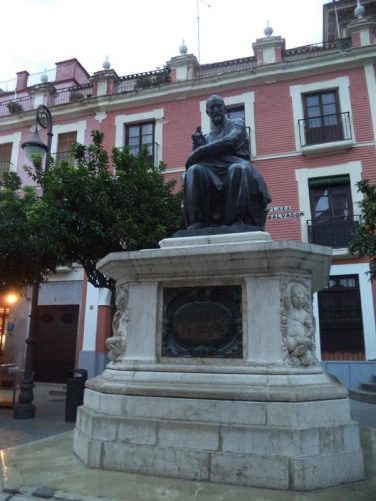 A bronze statue of Juan Martínez Montañés on a stone base in Plaza del Salvador. Martínez Montañés (1568-1649) was a renowned Spanish sculptor who was based in Seville.