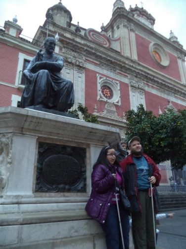 Tatiana and Tony in front of the Juan Martínez Montañés statue.