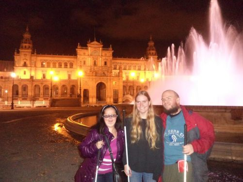Tony, Tatiana and one of their friends visiting from America. in front of the Vicente Traver Fountain in the evening.
