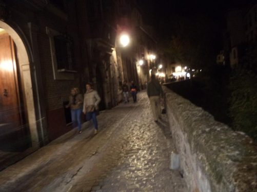 Carrera del Darro, a narrow historic street, running alongside the River Darro. Lit up in the evening. This narrow road is located east from Plaza Nueva and is located below the Albayzín – it eventually leads to the Paseo de los Tristes (Promenade of the Sad), a lively, picturesque plaza.