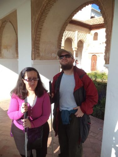 Tatiana and Tony under an archway at the side of the Patio de la Acequia.