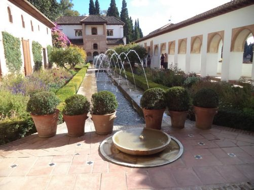 At the opposite end of the Patio de la Acequia. Lovely view of the pool, colourful flower beds and the surrounding palace buildings.