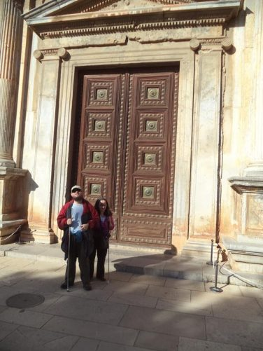 Tony and Tatiana at a main doorway into the Renaissance style Palace of Charles V.