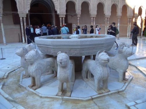 The stone lions. Water spraying from their mouths into a shallow channel in the floor.