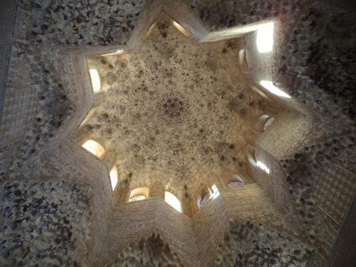Spectacular domed ceiling in the Hall of the Abencerrajes. Looking from below the dome makes the shape of an 8-pointed star. There are windows in the sides of the dome.