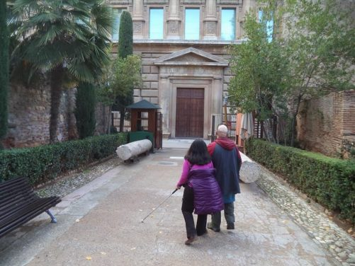Tatiana and Tony heading down a path towards the Palace of Charles V.