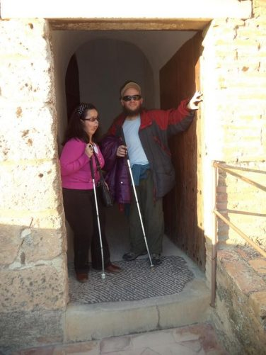 Tatiana and Tony standing in a doorway at the Alcazaba.