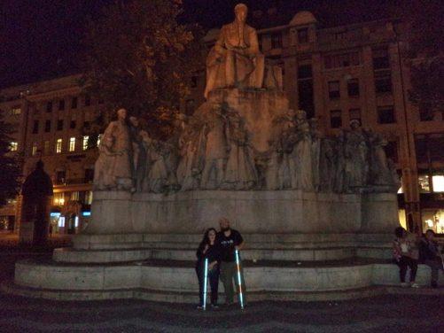 Tony and Tatiana in front of the statue of Mihály Vörösmarty in Vörösmarty Square.