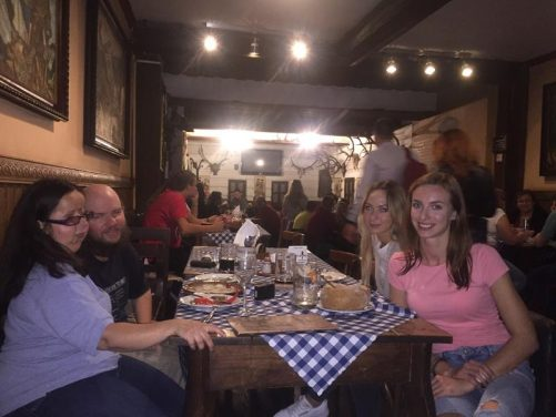 Sitting at a table in Slovak Pub. Tony with Tatiana, Viktoria and Livia.