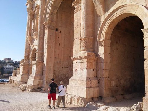 Tony and Brent walking in front of Hadrian's Arch.