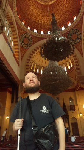 Tony inside the Mohammed Al Amin mosque. View up to the mosque's dome and a beautiful chandelier.