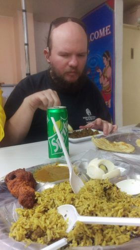 Tony eating inside Restaurant New Indo-Lanka in Dora Neighbourhood.