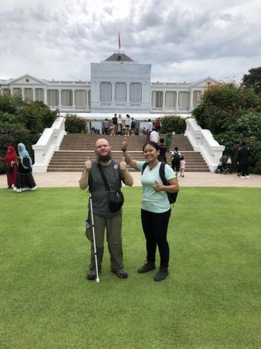 Tony and Juvena standing in the grounds of the Istana, which is the official residence and office of the President of Singapore.