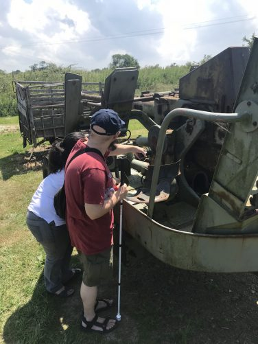 Tony and Tatiana touching a Landing Craft (LCVP). They were used by the allies on D-day to ferry men and equipment across the English Channel onto the Normandy beaches.