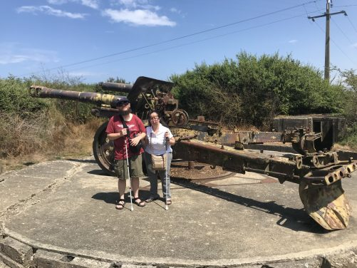 Tatiana and Tony in front of a 155mm First World War French howitzer, mounted on a circular concrete platform, allowing the gun to easily be pointed in any direction.