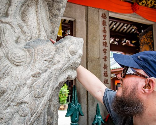 Tony touching a carved stone column with a dragon's head outside the entrance to Thian Hock Keng temple. The temple is both Taoist and Buddhist. It was built starting in 1842 by Chinese immigrants in honour of the sea goddess Mazu.