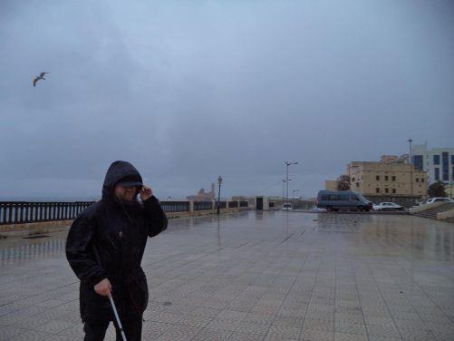 Tony at Promenade des Sablettes. In the distance a lighthouse and Fort Penon can be seen. The lighthouse, which occupies the site of Fort Penon, was built in 1544.