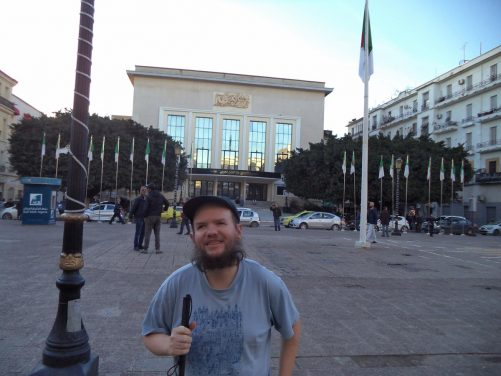 Tony in front of the National Theatre of Annaba (also known as Azzeddine Medjoubi Theatre).