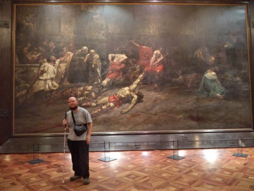 Tony inside the National Museum of Manila in front of a very large painting. The painting is Spoliarium by 19th century Filipino artist Juan Luna. It depicts the bloody carnage following a gladiatorial fight in ancient Rome. The dimensions of the painting are 4.2 by 7.6 metres.