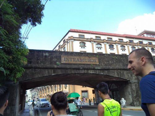 The group passing under a bridge through the walls into Intramuros.
