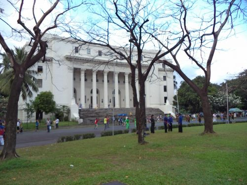 View towards the National Museum of Anthropology. The front façade is neoclassical in style, including a row of Corinthian columns across a portico.