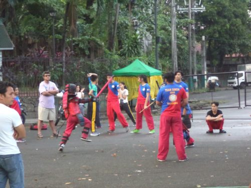 A group of young people, perhaps practising some sort of martial art, outside the National Museum of Anthropology.
