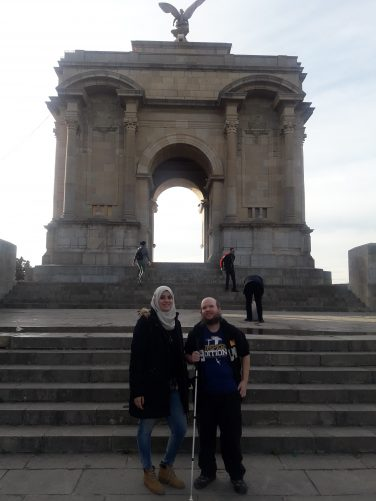 Tinhinane and Tony in front of Monument aux Morts arch.